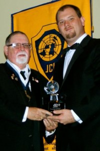 Cecil Deal receiving the Pioneer Award from JCI Florida President David Dale